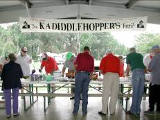 People at the buffet line at a Twin Bridges Gathering.